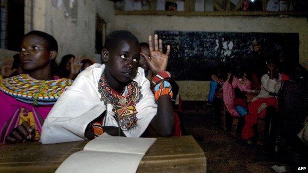 Samburu children attending evening lessons in solar-lit classrooms at Loltulelei primary school in Kenya - 2012