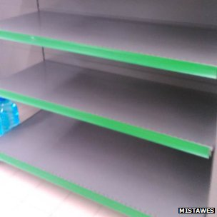 Empty shelves in a supermarket in Kiev