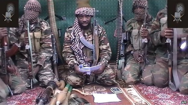 This screen grab taken on 25 September 2013 from a video distributed through an intermediary to local reporters and seen by AFP, shows a man claiming to be the leader of Nigerian Islamist extremist group Boko Haram Abubakar Shekau, flanked by armed men.