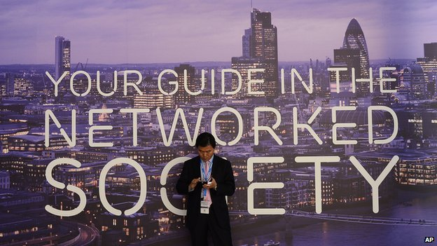 Man checking phone before networked society poster