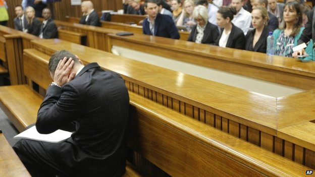 Oscar Pistorius blocks his ears inside the high court on the second day of his trial in Pretoria, South Africa, Tuesday, 4 March 2014