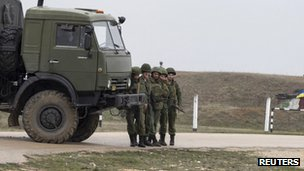 Russian solders watch Ukrainian servicemen play football at Belbek airport on 4 March 2014