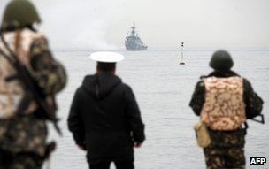 Ukrainian marines look at a Russian warship off Sevastopol, Crimea, 4 March