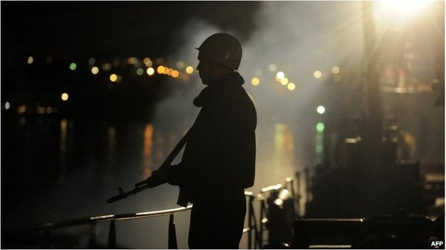 "A Ukrainian sailor guards the Ukrainian Navy ship the ""Slavutych"" blocked in the bay of Sevastopol on March 5"
