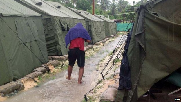 File photo: A man walking between tents at Australia's regional processing centre on Manus Island in Papua New Guinea