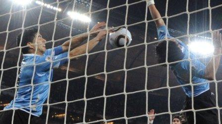 Uruguay's Luis Suarez handles the ball on the line against Ghana