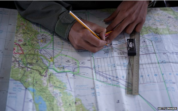 Marking locations on a map onboard a Malaysian Air Force flight
