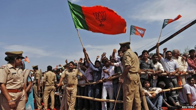 Supporters of Narendra Modi, PM candidate for Bharatiya Janata Party (BJP) and Gujarat's chief minister, attend a rally in Amroha, in the northern state of Uttar Pradesh March 29, 2014