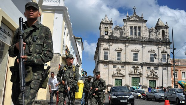 Brazilian soldiers patrol the historic centre of Salvador, Bahia, on February 7, 2012.