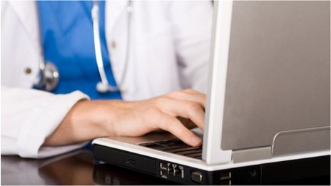 NHS worker on computer