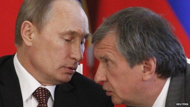 Russian President Vladimir Putin talks to Rosneft chairman Igor Sechin at the Kremlin (2 July 2013)