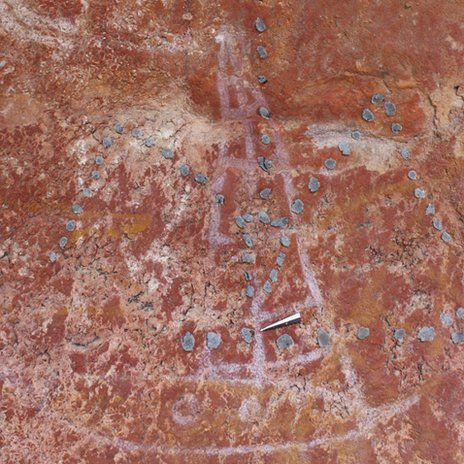 A cave painting of a Indonesian prau
