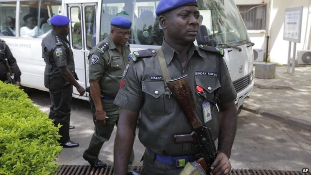 Security men stand guard outside a hospital in Abuja - 16 April 2014