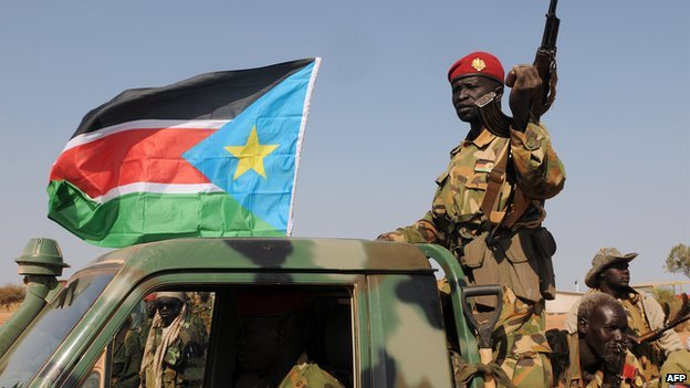 South Sudanese People's Liberation Army (SPLA) national army soldiers patrol the streets with a pick-up truck after capturing the town of Bentiu, on 12 January 2014.