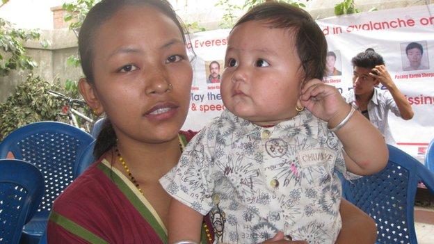 Menuka Magar-Gurung, widow of a Sherpa climber, and son
