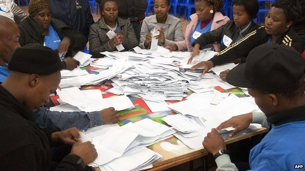 Independent Electoral Commission officials count ballots in Cape Town. 7 May 2014