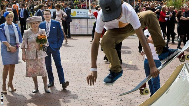 "Princess Beatrix of the Netherlands, her son Prince Constantijn and his wife Princess Laurentien look at a skateboard demonstration during the first King""s Day in Amstelveen"