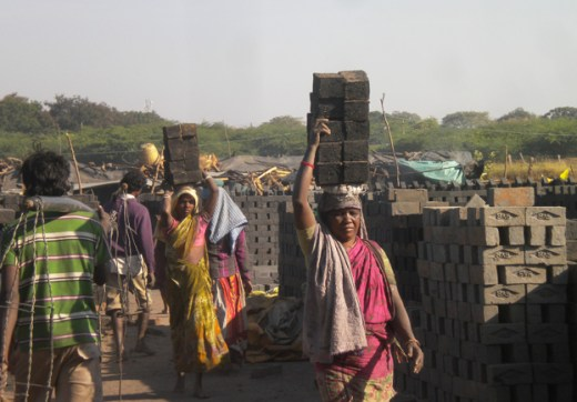 Women carrying bricks