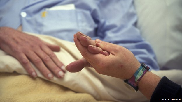 Picture of a hospice worker with a patient