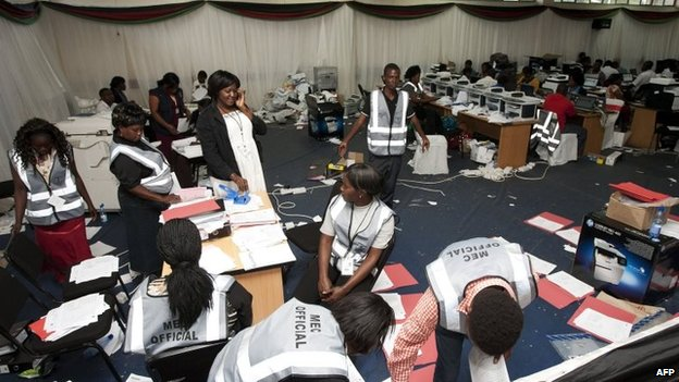 Malawi Electoral Commission workers continue to work out the results of Malawi's elections at the National Tally Centre in Blantyre, 28 May 2014