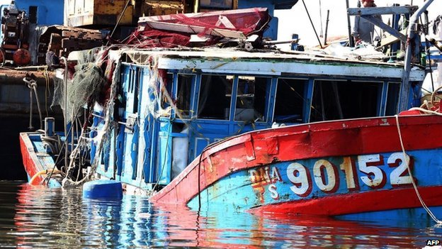 "This picture taken on June 2, 2014 shows the Vietnamese fishing boat ""DNA 90152"", which was reportedly sunk by a Chinese ship, at a shipyard in the central coastal city of Danang"