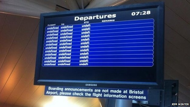 A departure information display monitor inside the airport terminal