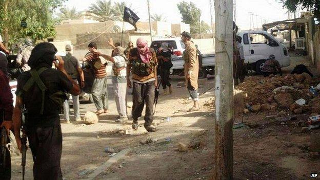 Militiamen in Tikrit, 11 June