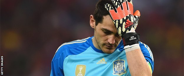 A dejected Iker Casillas after Spain are knocked out of the World Cup in Brazil