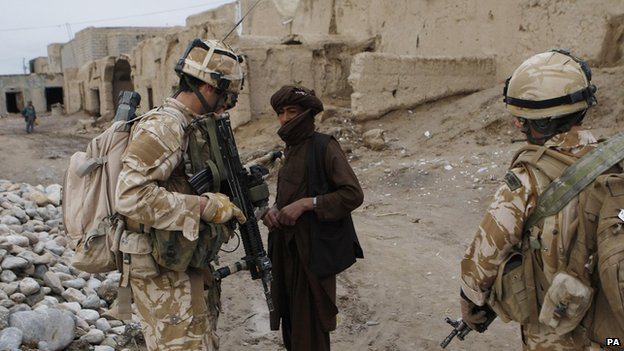 Royal Marines from 45 Command stop and search a man while on patrol in the Sangin district of Afghanistan 24 January 2009