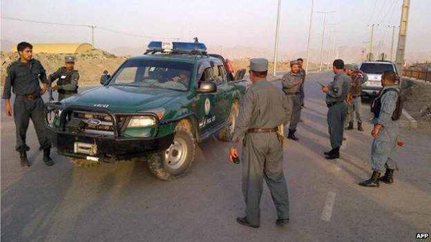 Afghan police arrive as a battle between insurgents and security forces takes place at Kabul's airport early on July 17