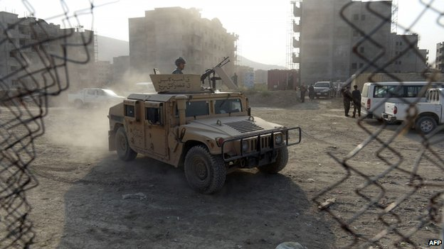 Afghan police arrive at the site of the attack