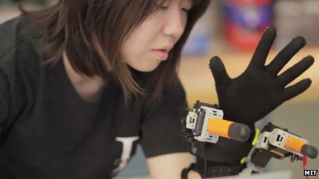 MIT researcher with robotic hand