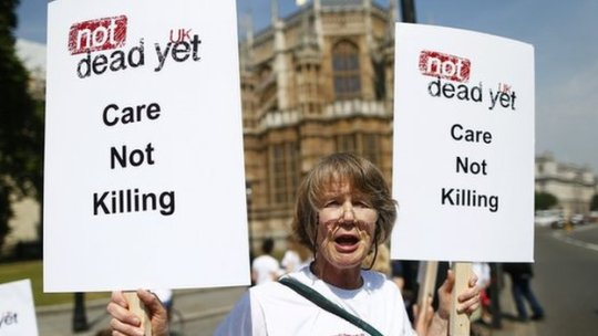 Opponent of assisted dying outside Parliament