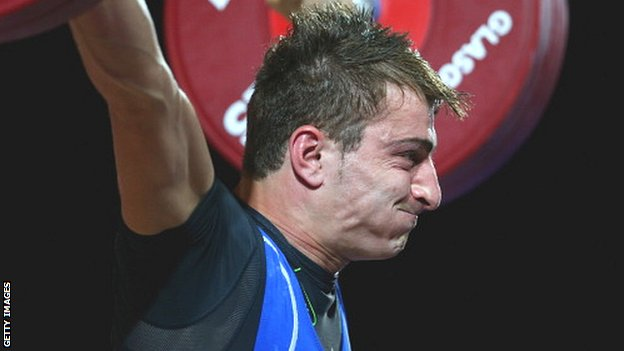 Dimitris Minasidis of Cyprus competes in the Men's 62kg Weightlifting