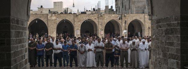 Palestinian Muslims mark Eid al-Fitr in Gaza City, 28 July