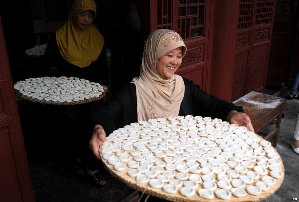 "Muslims prepare food as they gather in a mosque to celebrate Eid al Fitri in Tancheng, east China""s Shandong province on July 29, 2014"