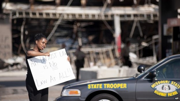 Protesters appeal to motorists for support while rallying on  in front of the QT gas station in Ferguson, Missouri 11 August 2014