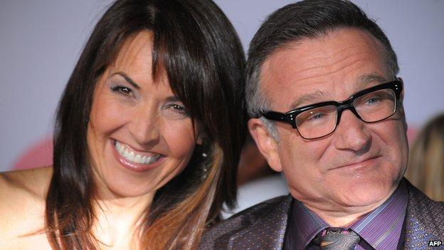 Williams with wife Susan Schneider