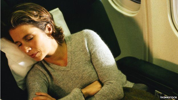 Woman asleep on plane