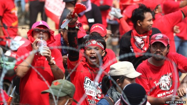 Red Shirt supporters of former PM Thaksin Shinawatra chant slogans at a television satellite centre on 9 April 2010 in Bangkok