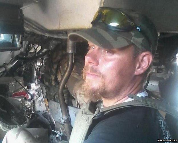Mikael Skillt inside an armoured car
