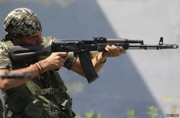 Spanish volunteer Rafa Munoz Perez practising with a rifle in Donetsk, 7 August
