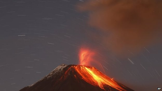 The Tungurahua volcano throws ash and stones during an eruption seen from Banos, Ecuador on 31 August, 2014.