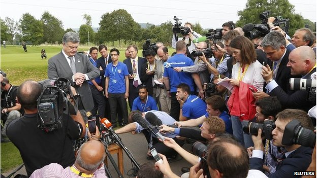 Ukraine's President Petro Poroshenko speaks to the media at the Nato summit