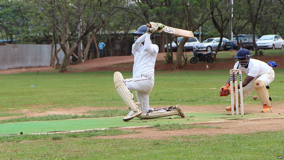 Cricketers play on 7 September 2014 at ETO Kicukiro, the former technical school of Kigali where thousands of Rwandans were killed during the 1994 genocide