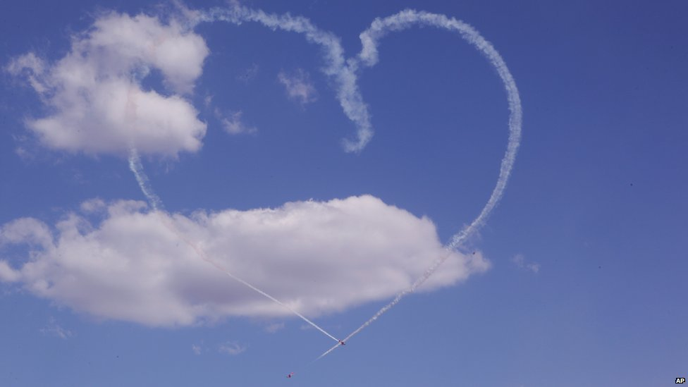 Planes draw a heart in the sky during formation displays at the largest Air Show to be held in Zimbabwe in more than 20 years, on the outskirts of Harare, Zimbabwe, 7  September 2014
