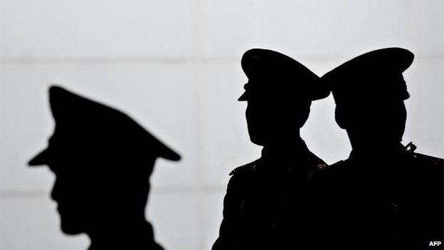 PLA soldiers stand guard at a metro station as visitors arrive at the site of the World Expo 2010 in Shanghai on 20 April 2010.