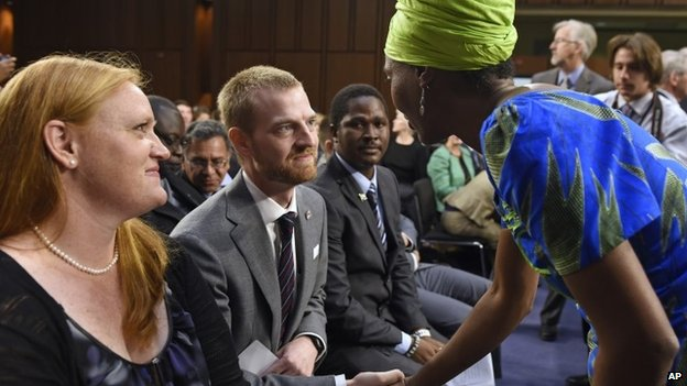 "Ebola survivor Dr Kent Brantly, former Medical Director of Samaritan""s Purse Ebola Care Center in Monrovia, Liberia, center, talks with Emira Woods, right, Director of Social Impact at ThoughtWorks, right, before the start of a hearing on Ebola before the Senate Appropriations Subcommittee on Labor, Health and Human Services, and Education on Capitol Hill 16 September 2014"