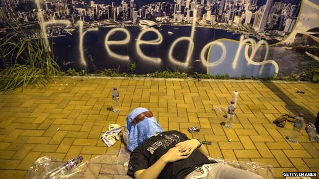 A protester sleeps on the streets outside the Hong Kong Government Complex at sunrise on 30 September 2014 in Hong Kong