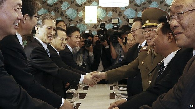 North Korea's delegation shakes hands with their South Korean counterparts after a meeting in Incheon, South Korea - 4 October 2014